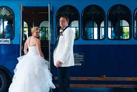 Bride and Groom in the blue Fairmont trolley